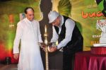 B.K Modi lighting the dia along with Subhash Chandra at Zee launches Buddha serial in J W Marriott in Mumbai on 2nd Sept 2013.JPG