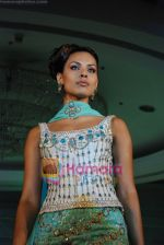 Model walks on the ramp for Tan Jewels fashion show in Taj Land_s End on May 3rd 2008(28).JPG