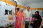 Nafisa-Ali-watching exhibition at A Documentary & Photo Exhibition on THE RED RIBBON EXPRESS CAMPAIGN .jpg