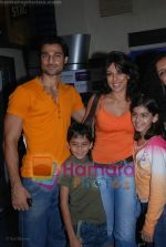 Pooja Bedi with Haneef and Kids at the Kung Fu Panda premiere in Fame on July 9th 2008(3).JPG