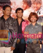 Directior Herry Fernandis with Ravikishan and Dineshlal Yadav at the music release of film Vidhata.jpg