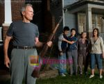 Clint Eastwood, Bee Vang, Ahney Her, Brooke Chia Thao, Chee Thao in still from the movie Gran Torino.jpg