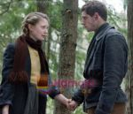 Jamie Bell, Mia Wasikowska in still from the movie Defiance.jpg