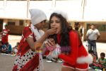 Sherlyn Chopra spends Christmas with kids in Bombay Central on 25th December 2008 (11).JPG