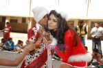 Sherlyn Chopra spends Christmas with kids in Bombay Central on 25th December 2008 (13).JPG