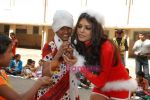 Sherlyn Chopra spends Christmas with kids in Bombay Central on 25th December 2008 (14).JPG