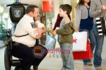 Kevin James, Dylan Clark Marshall in still from the movie Paul Blart - Mall Cop.jpg