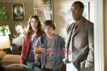 Don Cheadle, Emma Roberts, Jake T. Austin in a still from movie Hotel for Dogs.jpg