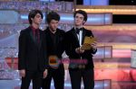 The Jonas Brothers at 66th Annual Golden Globe Awards on 13th Jan 2009 (36).jpg