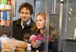 Hugh Dancy, Isla Fisher in still from the movie Confessions of a Shopaholic (2).jpg