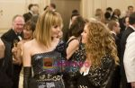 Leslie Bibb, Isla Fisher in still from the movie Confessions of a Shopaholic (1).jpg