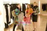 Leslie Bibb, Isla Fisher in still from the movie Confessions of a Shopaholic.jpg
