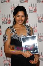 Frieda Pinto poses in the Press Roomwith her award for Best Actress at the ELLE Style Awards 2009 held at Big Sky London Studios on February 9, 2009 in London, England (2).jpg