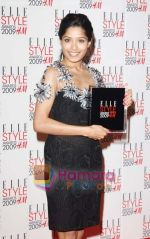 Frieda Pinto poses in the Press Roomwith her award for Best Actress at the ELLE Style Awards 2009 held at Big Sky London Studios on February 9, 2009 in London, England.jpg