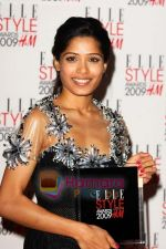 Frieda Pinto poses with her Best Actress Award at the Elle Style Awards 2009 at Big Sky Studios on February 9, 2009 in London, England (3).jpg