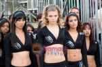 Nicole Tubiola, Smith Cho, AnnaLynne McCord in still from the movie FIRED UP.jpg