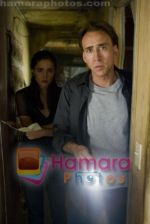 Nicolas Cage, Rose Byrne in still from the movie Knowing (2).jpg