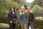 Carla Gugino, Dwayne Johnson, AnnaSophia Robb, Alexander Ludwig in still from the movie Race to Witch Mountain (2).jpg