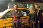 Cheech Marin, AnnaSophia Robb, Alexander Ludwig in still from the movie Race to Witch Mountain.jpg