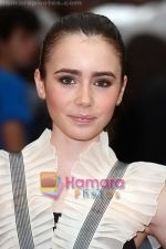 Lily Collins at the UK Premiere of movie HARRY POTTER AND THE HALF BLOOD PRINCE on 7th JUly 2009 in Odeon Leicester Square.jpg