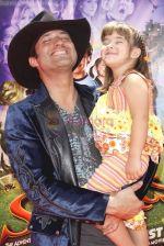 Robert Rodriguez and Rhiannon Rodriguez at the Premiere Of SHORTS held at The Grauman_s Chinese Theatre in Hollywood, California, USA on Aug 15th 2009 - IANS-WENN.jpg