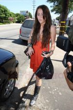 Miley Cyrus at the hair and tanning salon with mum in Studio City, Los Angeles, California - 23rd August 2009 - IANS-WENN (2).jpg