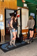 Miley Cyrus leaving Katsu-Ya sushi restaurant with friends in Studio City, California on 25th August 2009 - IANS-WENN (2).jpg