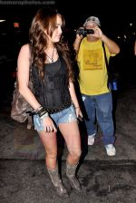 Miley Cyrus leaving Katsu-Ya sushi restaurant with friends in Studio City, California on 25th August 2009 - IANS-WENN (7).jpg
