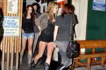 Miley Cyrus leaving Katsu-Ya sushi restaurant with friends in Studio City, California on 25th August 2009 - IANS-WENN.jpg