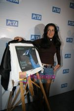 Celina Jaitley unveils the annual PETA calendar in Bandra, Mumbai on 29th Dec 2009 (31).JPG