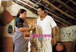 Om Puriand Smita Jayakar in the still from movie The Hangman.jpg