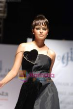 Model walks the ramp for Umair Zafar show in Rennaisance Club on 31st March 2010 (2).JPG