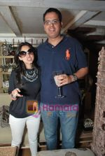 rinkie with husband samir at Twinkle Khanna_s The White Window  launch of holiday line Villa Tara in Bandra on 9th April 2010.JPG