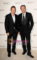Benoit Magimel shares a moment with Daniel Lalonde at Moet Chandon event.JPG