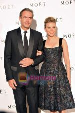 Scarlett Johansson and Moet CEO and President at Moet Chandon event.JPG