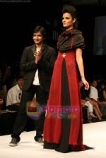 Model walks the ramp for Arjun Show at Lakme Winter fashion week day 4 on 20th Sept 2010.JPG