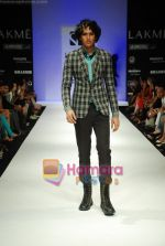 Model walks the ramp for Sanjay Hingu Show at Lakme Winter fashion week day 3 on 19th Sept 2010.JPG