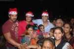 John Abraham, Akshay Kumar, Ritesh Deshmukh spend christmas with children of St Catherines in Andheri on 25th Dec 2010 (59).JPG
