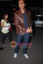 Arjun Rampal leave for Zee Awards in Singapore in Mumbai Airport on 12th Jan 2011 (48).JPG