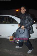 Karan Johar leave for Zee Awards in Singapore in Mumbai Airport on 12th Jan 2011 (10).JPG