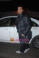 Karan Johar leave for Zee Awards in Singapore in Mumbai Airport on 12th Jan 2011 (32).JPG