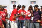 RJ Sidhu recieving the winner_s trophy from Jay Bhanushali and Amruta Patk at Fashion at Big Bazaar & Percept Media presents Cricket Day in SRPF Ground, Goregaon on 19th Feb 201i.JPG