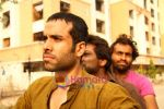 Tusshar, Nikhil Dwivedi and Pithobash in the still from Shor In The City.JPG