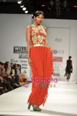 Model walks the ramp for Koga show on Wills Lifestyle India Fashion Week 2011-Day 4 in Delhi on 9th April 2011 (11).JPG