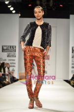 Model walks the ramp for Koga show on Wills Lifestyle India Fashion Week 2011-Day 4 in Delhi on 9th April 2011 (24).JPG