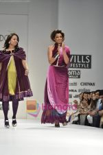 Mugdha Godse walks the ramp for Pallavi Jaipur show on Wills Lifestyle India Fashion Week 2011-Day 4 in Delhi on 9th April 2011 (10).JPG