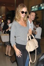 Rosie Huntington-Whiteley snapped on arrival at Kansai International Airport, Japan on 15th July 2011 (1).jpg