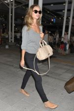 Rosie Huntington-Whiteley snapped on arrival at Kansai International Airport, Japan on 15th July 2011 (2).jpg