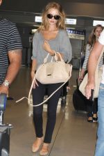 Rosie Huntington-Whiteley snapped on arrival at Kansai International Airport, Japan on 15th July 2011 (6).jpg