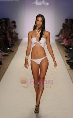 A model walks the runway at the A.Z Araujo AG Uaclara Aquarella Swimwear show during Merecedes-Benz Fashion Week Swim 2012 on July 18, 2011 in Miami Beach, United States (1).JPG